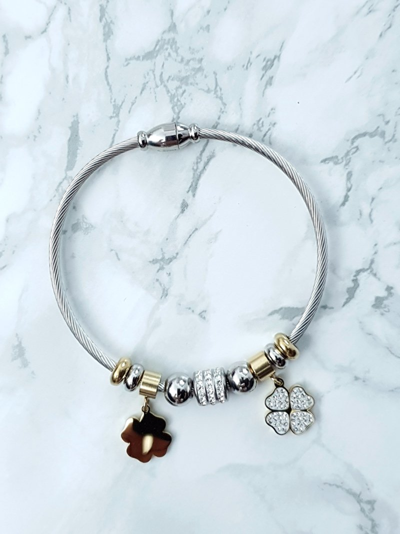 Women S Bracelet On Steel Cord With Gold Shamrock Charms